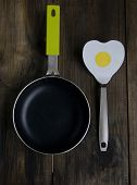 Frying pan with a spatula in the form of heart