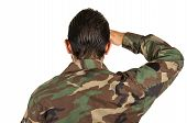 rear view of man in military uniform saluting