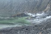 pic of vapor  - Vapors and gases rising from hot hydrothermal system next to lake in crater of El Chichon volcano in Chiapas Mexico on December 19 2014 - JPG