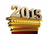 The number 2015 on a golden pedestal over white background with brilliant lights