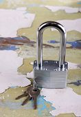 Padlock with keys on wooden background