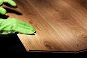 stock photo of laminate  - Carpenter worker installing laminate flooring  - JPG