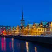 Old Stock Exchange at night in Copenhagen Denmark.