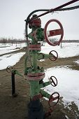 The mouth of the oil wells on the valve and pump.