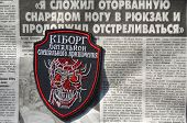Kiev,Ukraine.Oct 16.Illustrative editorial.Ukrainian Army unformal chevron Kiborg. Newspaper with heroic story of soldier as background.At October 16,2014 in Kiev, Ukraine
