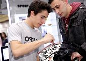 BARCELONA - DEC, 9: World champion motocycle racer Marc Marquez autograph signing in shopping center on December 9, 2014 in Barcelona, Spain