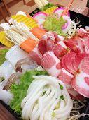 foto of shabu  - closed up sliced pork shrimp noodle and vegetables for shabu set - JPG