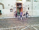 Three Cyclist Girls Leaving The Cafe
