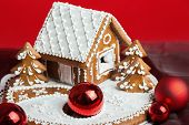 Holiday Gingerbread House On Red.