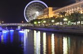 SHARJAH, UNITED ARAB EMIRATES - DECEMBER 19, 2014: Photo of Al Qasba Canal and ferris wheel.