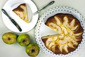 picture of pie-in-face  - Homemade italian baked apple pie over a white table - JPG