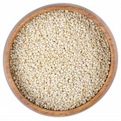 picture of quinoa  - Raw quinoa seeds in a wooden bowl from above - JPG