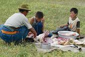 Mongolian men cut mutton meat, Harhorin, Mongolia.