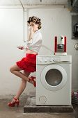 portrait of pretty woman in laundry, interior