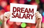 Dream Salary card with colorful background with defocused lights