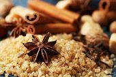 Christmas spices and baking ingredients on color napkin, on wooden background
