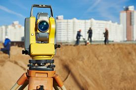 stock photo of geodesic  - Surveyor equipment tacheometer or theodolite outdoors at construction site - JPG