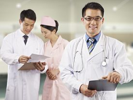 pic of hospital gown  - portrait of an asian medical team posing in hospital - JPG