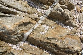 image of calcite  - Calcite vein in rock at Rocky Point Tangalle Southern Province Sri Lanka Asia - JPG