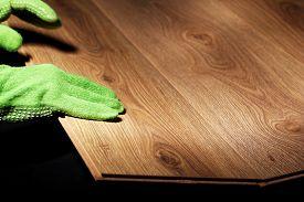 picture of laminate  - Carpenter worker installing laminate flooring  - JPG