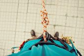 image of harness  - Climber man standing in harness with rope and knot Eight - JPG