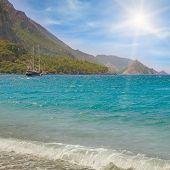 picture of sea-scape  - sea scape blue sky and mountainous coast - JPG
