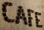 stock photo of spit-roast  - Roasted coffee beans making the word  - JPG