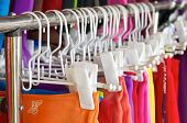picture of clothes hanger  - Row of colorful skirt with white clothes hanger in clothing market - JPG