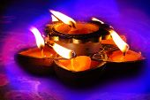 stock photo of diwali  - Traditional ritual lamps lit up on the occassion of Diwali festival in India - JPG