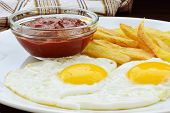 foto of french fries  - Fried eggs with french fries and ketchup on white plate - JPG