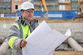 picture of inspection  - Civil Engineer at at construction site is inspecting ongoing production according to design drawings - JPG