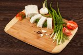 foto of pita  - pita bread with green onion and tomato on a wooden table - JPG