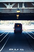 picture of girder  - Dedicated bus lane under a steel girder bridge with illuminated streetlights - JPG