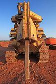 stock photo of bulldozer  - rock breaker on a bulldozer on construction site - JPG
