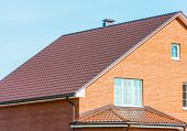 picture of chimney  - chimney on the roof of the house against the blue sky - JPG