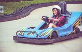 stock photo of karts  - Cute Thai girl is driving Go - JPG
