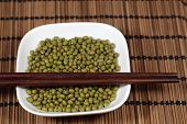 stock photo of mung beans  - A macro photograph of fresh mung beans - JPG