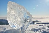stock photo of crystal clear  - Crystal clear ice at sunny day at frozen sea - JPG