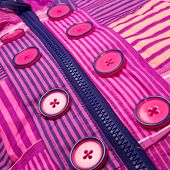 pic of zipper  - Close up zipper and button on a colorful background - JPG