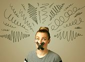 picture of taboo  - Young woman with taped mouth and curly lines around her head - JPG