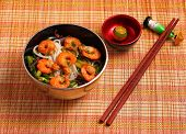 foto of rice noodles  - Vietnamese shrimp and rice noodles soup pho served on a bamboo place mat - JPG