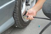 stock photo of check  - Inflate tires and check Pressure of tires - JPG