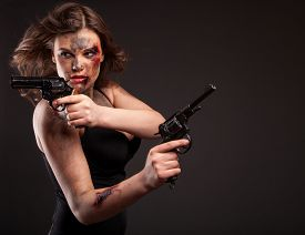 stock photo of girls guns  - Sexy woman with gun - JPG