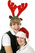 Adorable Teen Couple In Christmas Hats.