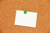cork board background with a paper note