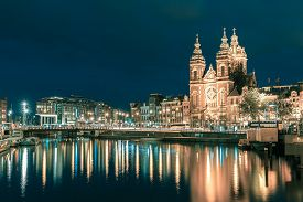 picture of saint-nicolas  - Night city view of Amsterdam canal and Basilica of Saint Nicholas - JPG