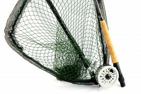 pic of fly rod  - A fly fishing outfit of rod reel and landing net isolated on a white background - JPG