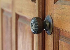 pic of keyholes  - door handle keyhole with old design on brown wood door - JPG