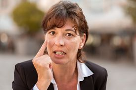 picture of middle finger  - Close up Angry Middle Aged Businesswoman Pointing her Finger and Looking at the Camera - JPG