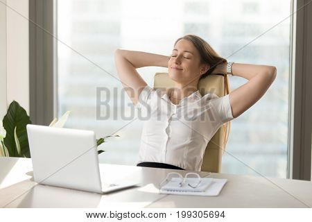 poster of Calm smiling businesswoman relaxing at comfortable office chair hands behind head, happy woman resting in office satisfied after work done, enjoying break with eyes closed, peace of mind, no stress